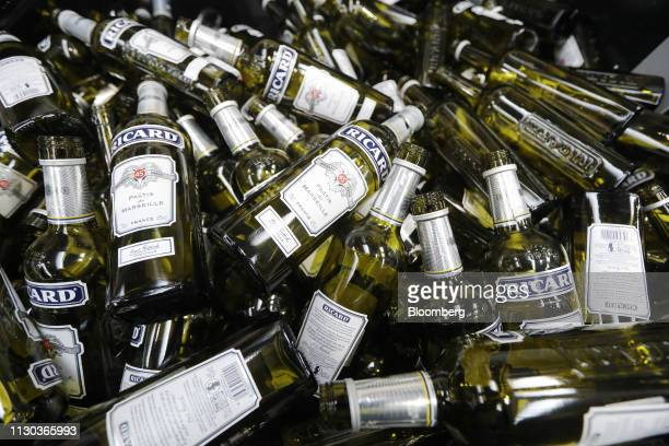 Empty Pernod Pastis bottles sit in a bin after failing quality control checks at the Pernod Ricard SA alcoholic beverage plant and warehouse in...