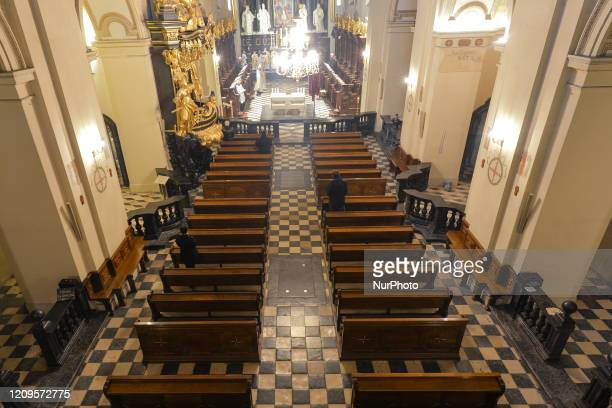 Empty pews inside the Benedictine monastery in Tyniec during the Holy Thursday mass led by Father Szymon Hizycki Abbot of the monastery On Thursday...