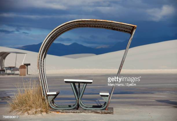 Empty Picnic Table And Bench At White Sands National Monument Against Sky