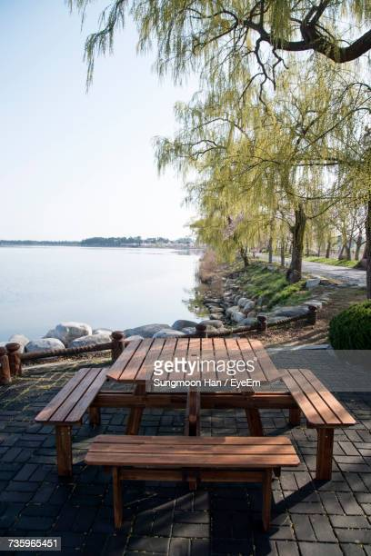 empty picnic table at lakeshore - picnic table stock pictures, royalty-free photos & images