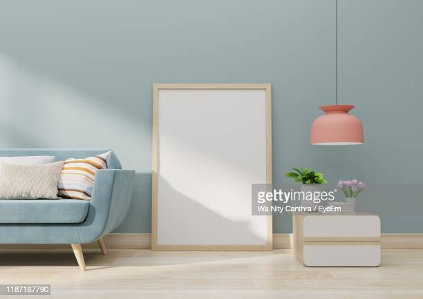 empty picture frame by sofa at home - pendant light stock pictures, royalty-free photos & images
