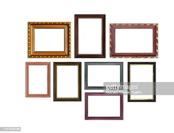 empty picture frames against white background - photography stock pictures, royalty-free photos & images