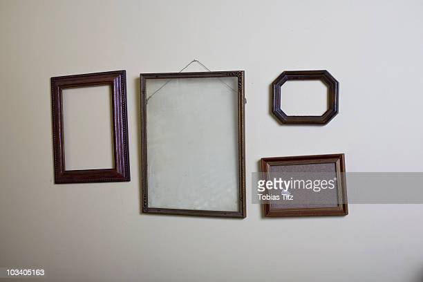 Empty picture frames hanging on a wall
