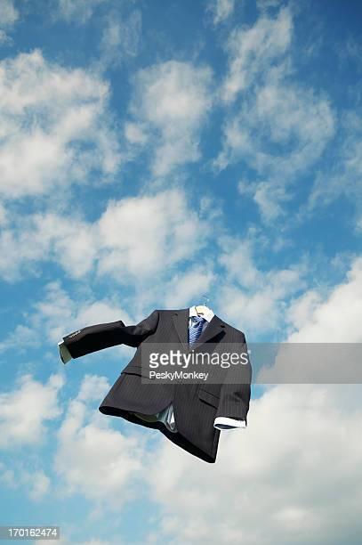Empty Pinstripe Suit Floats in Clouds Blue Sky