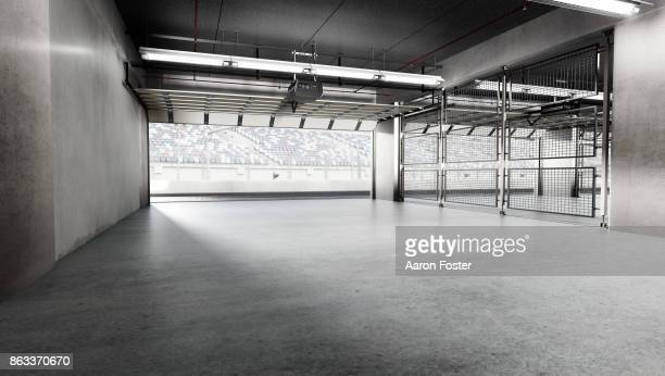 empty pit garage - sports track stock pictures, royalty-free photos & images