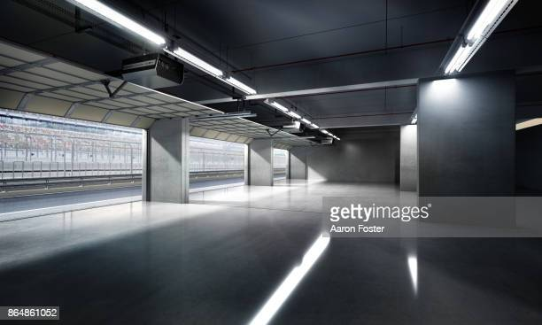 empty pit garage - motor racing track stock pictures, royalty-free photos & images