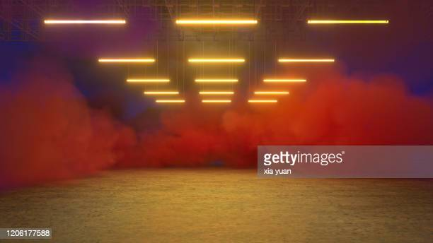 empty pit garage with colored smoke - kleurenfoto stockfoto's en -beelden