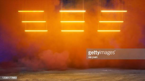empty pit garage with colored smoke - danger stock pictures, royalty-free photos & images