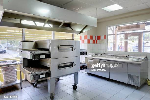 empty pizza kitchen - pizzeria stock pictures, royalty-free photos & images
