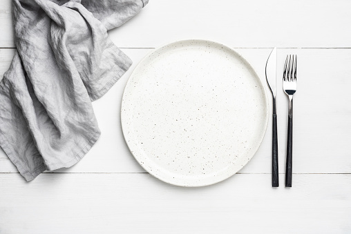 Empty plate, cutlery and linen textile 1139597753