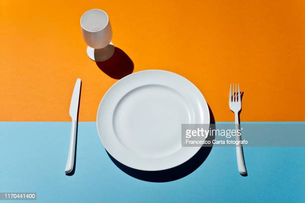 empty plate table setting - plain stock pictures, royalty-free photos & images