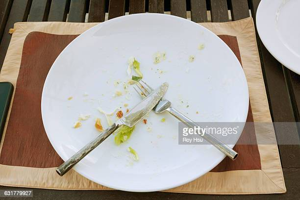 empty plate with crumbs and fork and knife - the end stock pictures, royalty-free photos & images