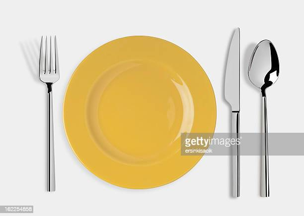 empty plate with knife, spoon and fork - fork stock pictures, royalty-free photos & images