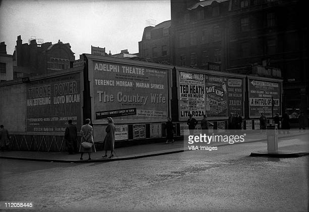 Empty plot on corner of Shaftsbury Avenue with advertising hoardings showing theatre posters London 1950