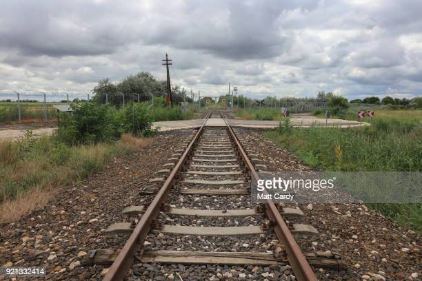 Empty rail road tracks lead to what was the opening in the SerbianHungarian border taken by thousands of migrants last year on July 16 2016 in Roszke...