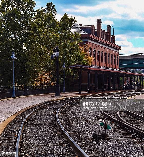empty railroad station against cloudy sky - cumberland usa stock photos and pictures