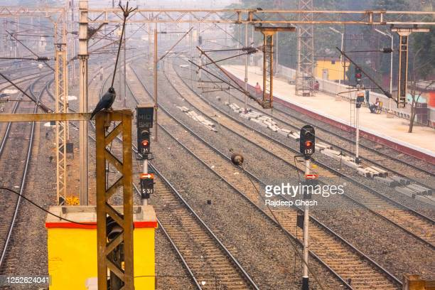 empty railway station and train tracks in india - strike industrial action stock pictures, royalty-free photos & images