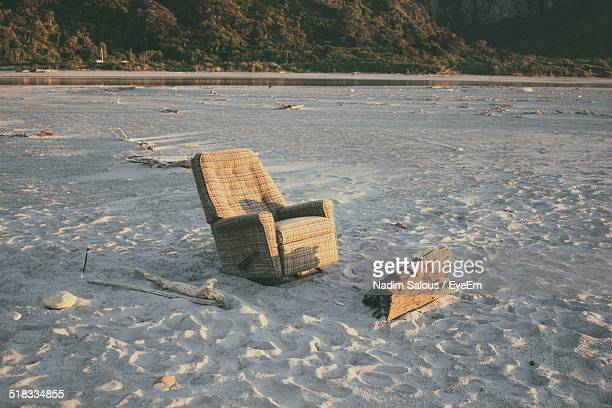 empty reclining chair on beach - reclining chair stock photos and pictures