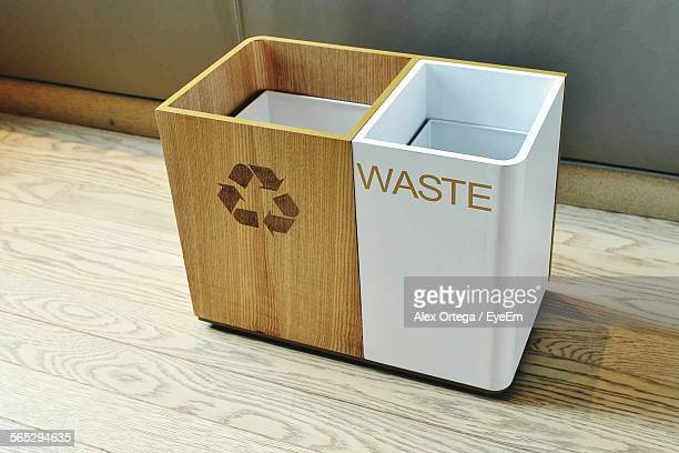 Empty Recycle Bins Kept On Hardwood Floor