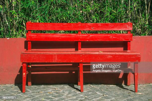 Empty Red Bench On Sunny Day