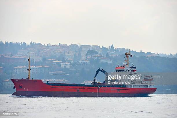 empty red cargo ship in bosphorus - emreturanphoto stock pictures, royalty-free photos & images