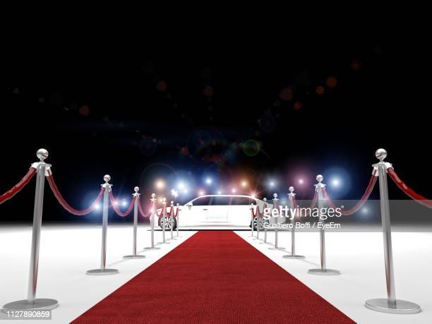 empty red carpet by bollards at night - red carpet event stock pictures, royalty-free photos & images
