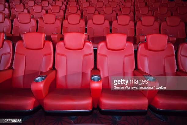 empty red chairs at theater - seat stock pictures, royalty-free photos & images