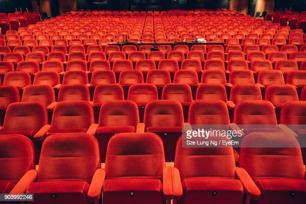 Empty Red Chairs In Auditorium