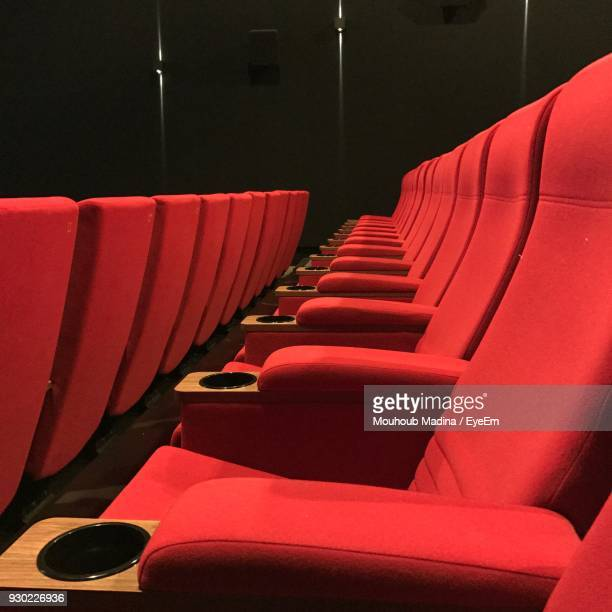 Empty Red Chairs In Movie Theater