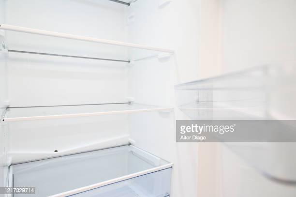 empty refrigerator with open door. - empty fridge stock pictures, royalty-free photos & images