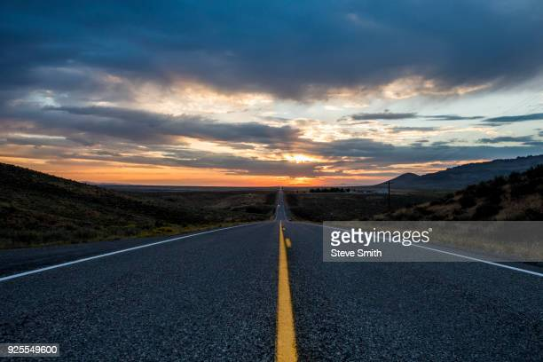 Empty remote road at sunset