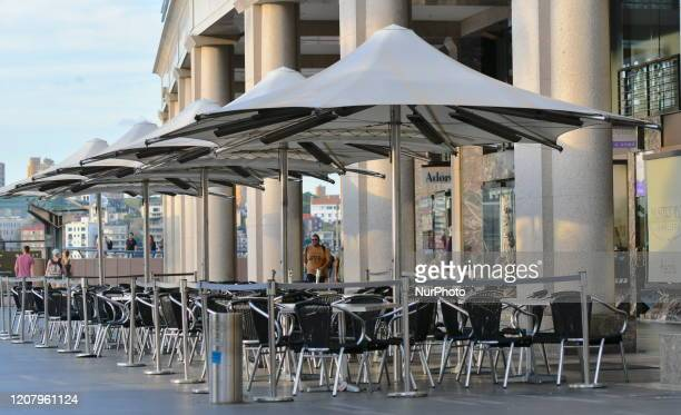 A empty restaurant tables is seen at Circular Quay in Sydney Australia on March 22 Earlier in the week nonessential gatherings of 100 or more people...