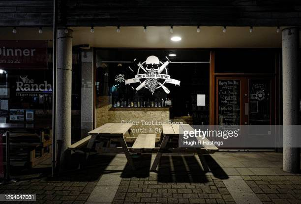 Empty restaurant tables outside popular locations on January 5, 2021 in Falmouth, United Kingdom. The British Prime Minister made a national...