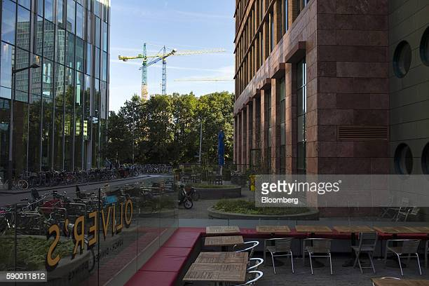 Empty restaurant tables sit outside commercial office properties in the Zuidas business district of Amsterdam Netherlands on Monday Aug 15 2016 The...