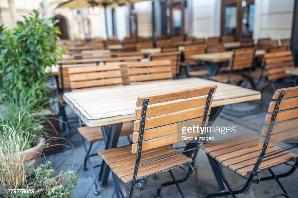 empty restaurant terrace during quarantine against coronavirus - covid-19 - chair stock pictures, royalty-free photos & images