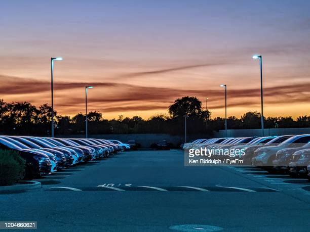 empty road against blue sky at sunset - car dealership stock pictures, royalty-free photos & images