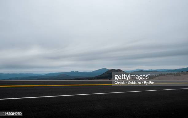 empty road against cloudy sky - christian soldatke stock pictures, royalty-free photos & images