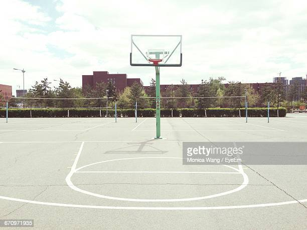 empty road against cloudy sky - basketball hoop stock pictures, royalty-free photos & images
