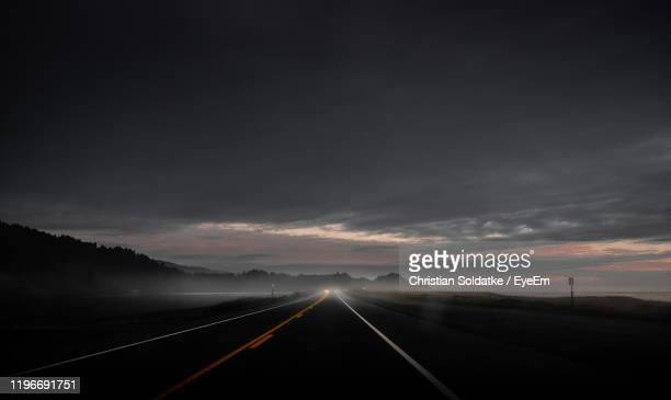 empty road against sky during sunset - christian soldatke stock pictures, royalty-free photos & images