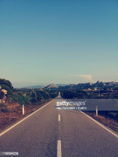 empty road against sky - tempio pausania stock pictures, royalty-free photos & images