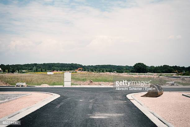 empty road against sky - albrecht schlotter stock pictures, royalty-free photos & images