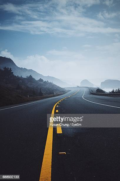 empty road against sky - double yellow line stock photos and pictures