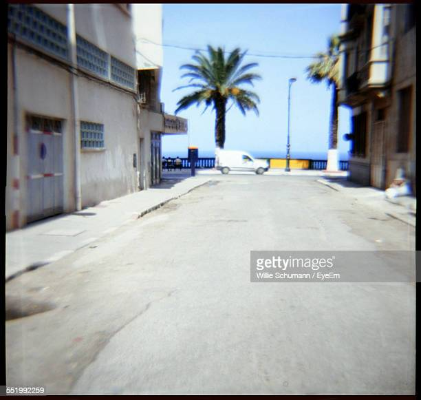 empty road along built structures - oran algeria photos et images de collection