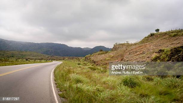 empty road along countryside landscape - andres ruffo stock pictures, royalty-free photos & images