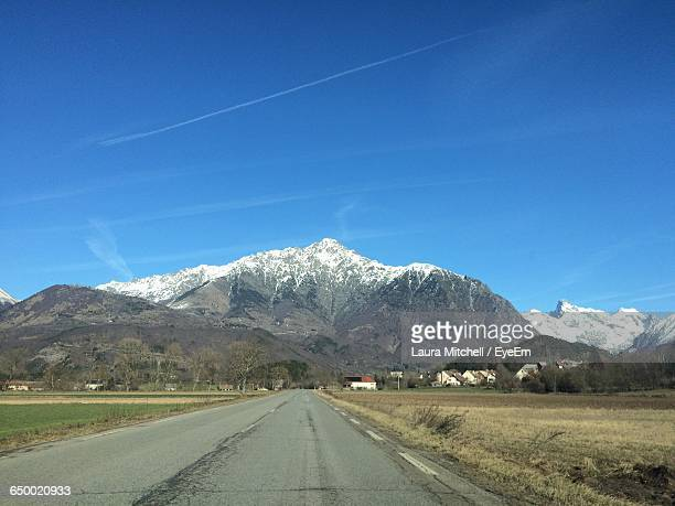 empty road along countryside landscape - isere stock pictures, royalty-free photos & images