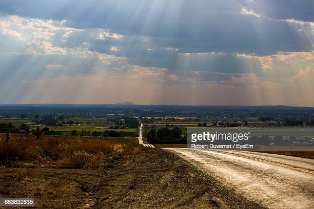 empty road along countryside landscape - idaho falls stock pictures, royalty-free photos & images
