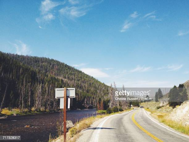 empty road along countryside landscape - idaho falls stock photos and pictures