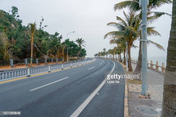 empty road along the sea - liyao xie stock pictures, royalty-free photos & images