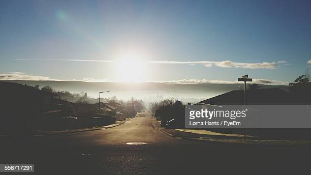 empty road amidst houses against sky - launceston australia stock pictures, royalty-free photos & images
