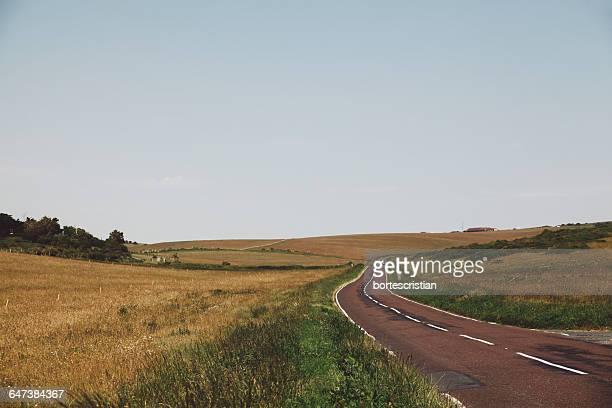 empty road amidst landscape against sky - bortes cristian stock-fotos und bilder